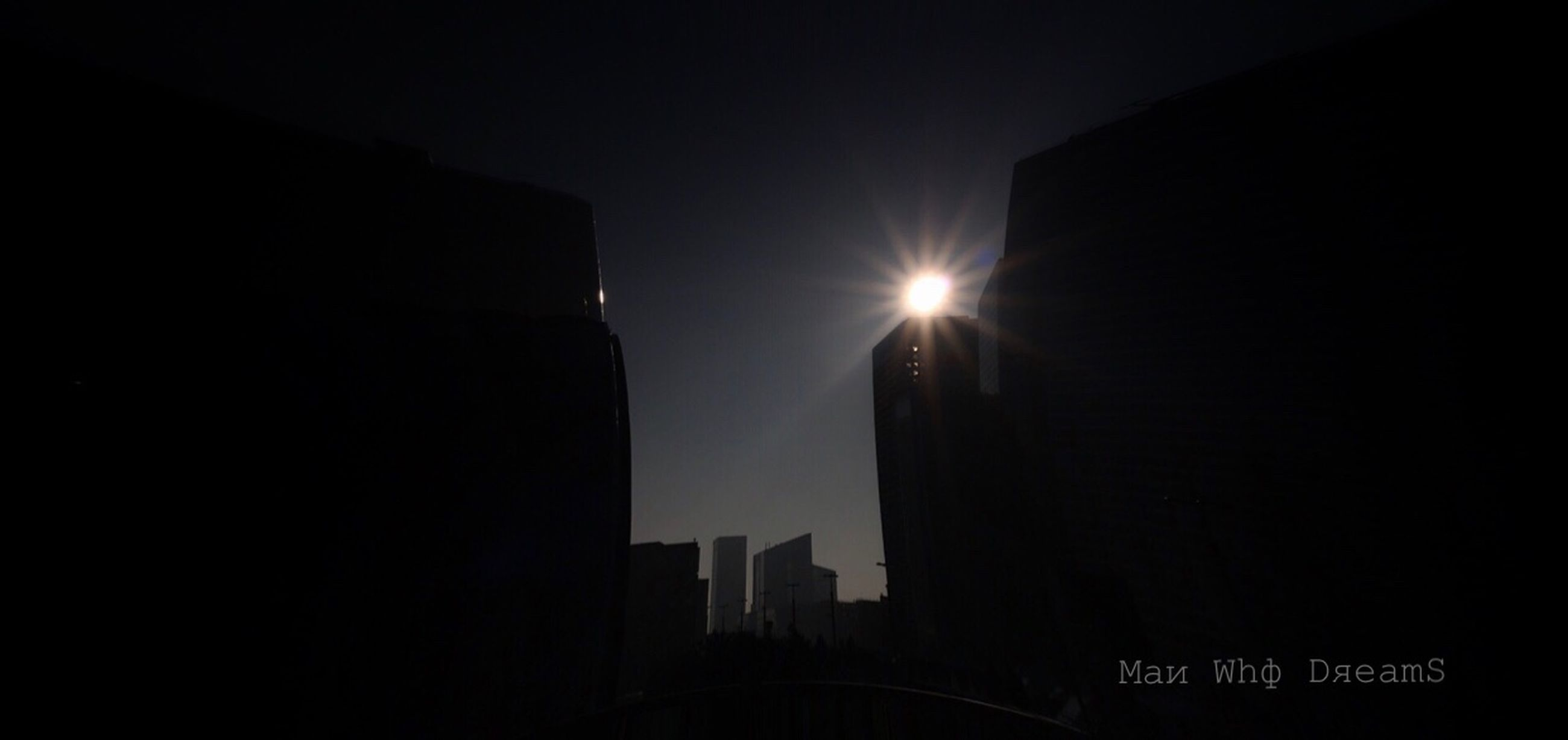 built structure, building exterior, sky, architecture, no people, sun, low angle view, building, nature, silhouette, lens flare, city, illuminated, copy space, outdoors, sunlight, tower, dark, clear sky, skyscraper