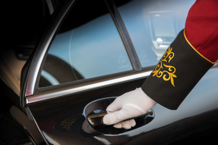 Cropped Hand Of Driver Wearing Glove Opening Car Door