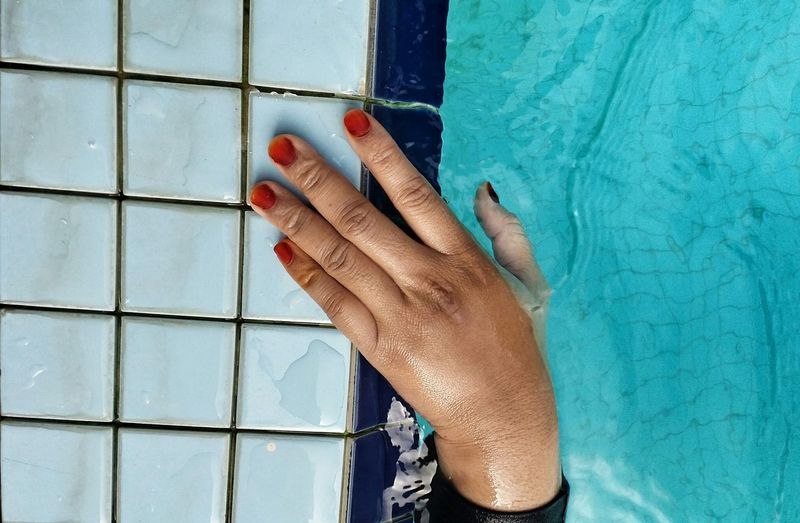 Cropped Image Of Hand In Swimming Pool