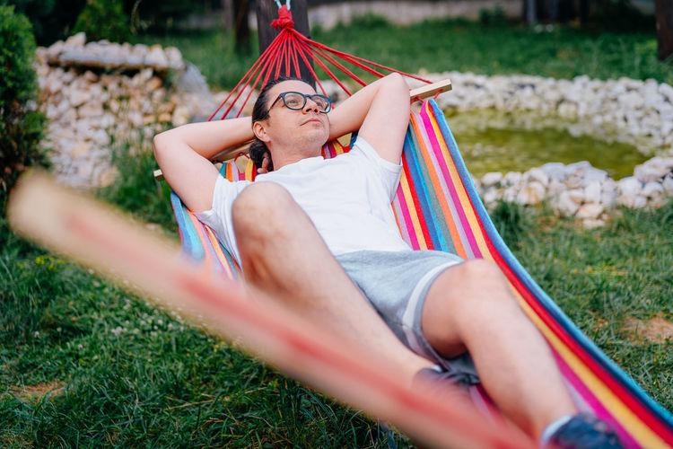 Man relaxingin hammock in the yard