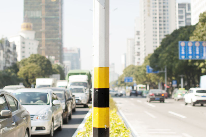 Close-Up Of Yellow Traffic On Road In City