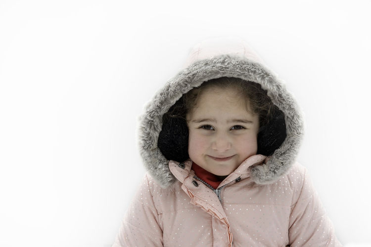 Portrait of a smiling girl over snow