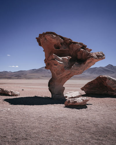 Salar De Uyuni Rock Formation Tranquility Desert Solid Rock Rock - Object Landscape Tranquil Scene Physical Geography Environment Scenics - Nature Geology Nature Sky Non-urban Scene Climate Arid Climate Land No People Beauty In Nature Eroded Outdoors