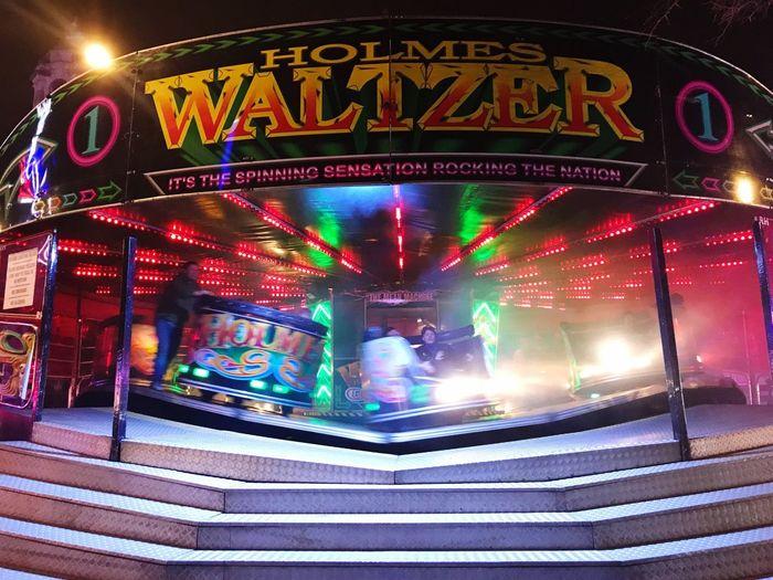 Waltzer Fairground Ride Waltzers Illuminated Night Text Arts Culture And Entertainment Multi Colored Lighting Equipment Amusement Park Amusement Park Ride Carousel