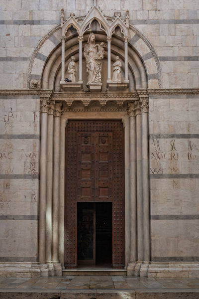 Catholic church San Michele in Borgo in Pisa, Tuscany, Italy Pisa Arch Architectural Column Architecture Bas Relief Belief Building Building Exterior Built Structure Closed Day Door Eingang Entrance Façade History Old Ornate Outdoors Place Of Worship Religion San Michele The Past Wall Wall - Building Feature