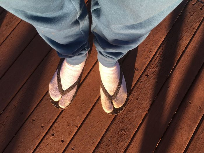 Wearing track pants socks and flip flops. Low Section Human Leg Shoe Day One Person Outdoors Real People Standing People Blue Socks Bad Taste Bad Fashion Flip Flops Thongs Mismatch Be. Ready.