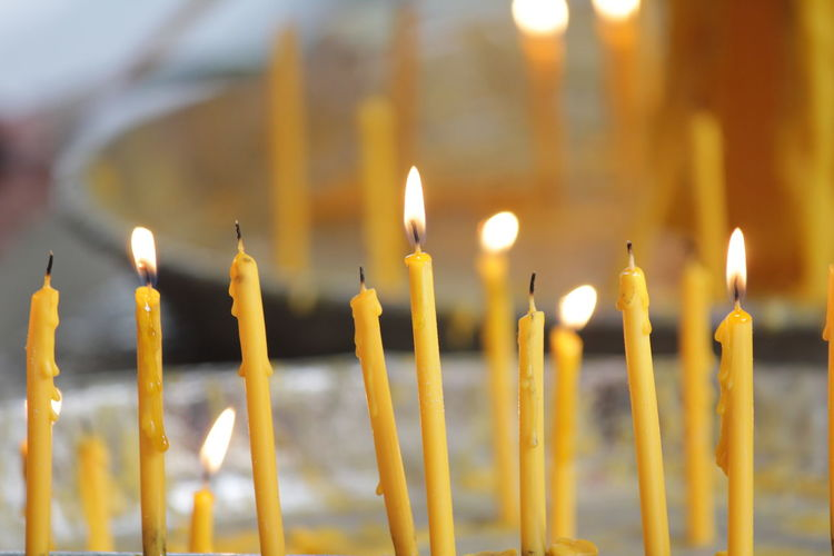 Burn candles to worship sacred things Burn Candles To Worship Sacred Things Burning Candle Close-up Day Fire - Natural Phenomenon Flame Focus On Foreground Glowing Heat - Temperature Illuminated Indoors  Melting No People Place Of Worship Religion Selective Focus Spirituality Yellow
