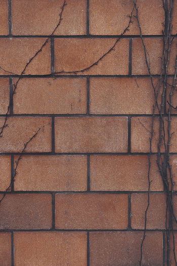 Full-frame background with a repeating symmetrical brick pattern