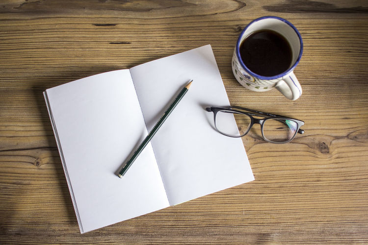 Writing Black Coffee Blank Blank Page Book Coffee Coffee - Drink Coffee Cup Cup Drawing Drink Eyeglasses  Flat Lay Glasses High Angle View Indoors  Mug Paper Pen Pencil Still Life Table Wood - Material