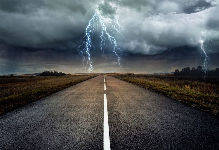 Cloud - Sky Road Sky The Way Forward Direction Transportation Storm Empty Road Power Sign Storm Cloud No People Diminishing Perspective Beauty In Nature Power In Nature vanishing point Lightning Environment Nature Electricity