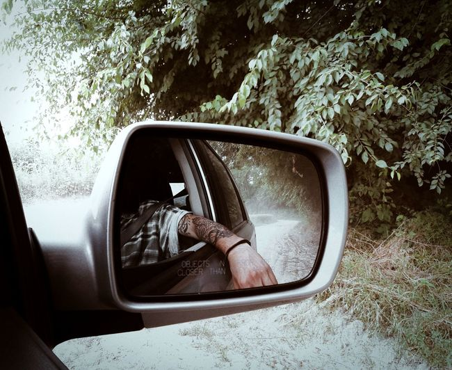 Live For The Story Car Transportation Mode Of Transport Side-view Mirror Outdoors Window Day Road Photo Of The Day Picture Of The Day Tree Vehicle Mirror One Person Hand Travel Photography Adventures The Great Outdoors - 2017 EyeEm Awards