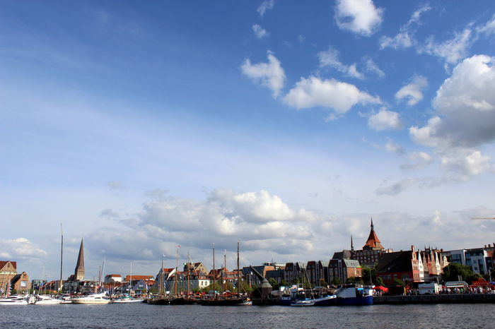 Blue Boat Building Exterior Built Structure Capital Cities  City City Life Cityscape Cloud Cloud - Sky Cloudy Harbor Mode Of Transport Nautical Vessel Outdoors Residential District River Rostock Sailboat Sky Skyline Tourism Travel Destinations Water Waterfront