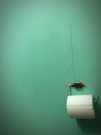 Toilet paper roll on holder in bathroom