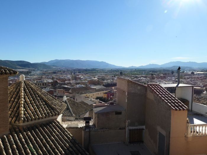 Roof tops of Mula, Spain EyeEm Selects Architecture Sky Built Structure Building Exterior City Nature Building Sunlight Day Copy Space Mountain Residential District Clear Sky High Angle View Cityscape Roof Outdoors No People Office Building Exterior TOWNSCAPE