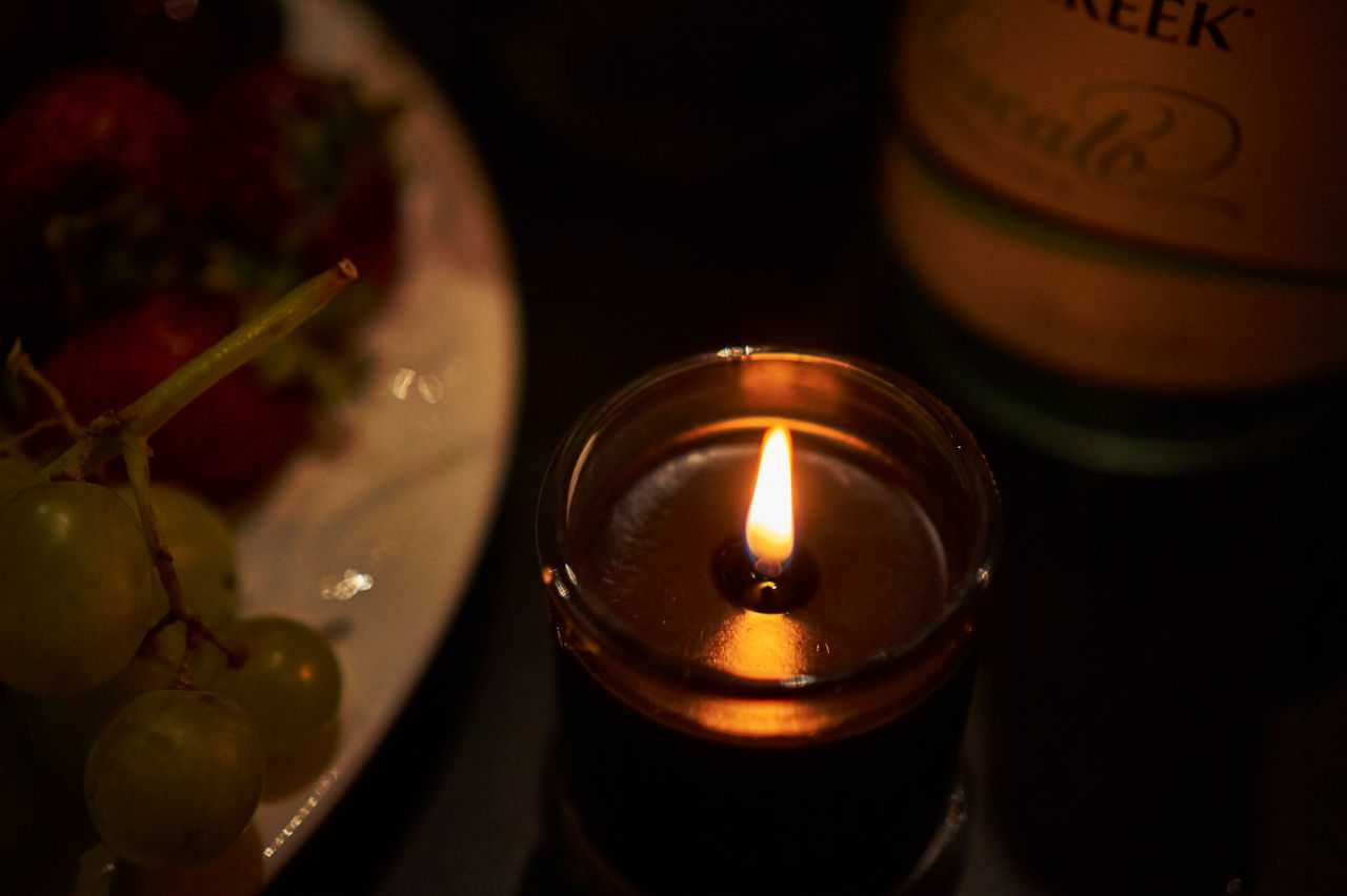candle, flame, burning, tea light, heat - temperature, indoors, high angle view, no people, close-up, table, illuminated, day