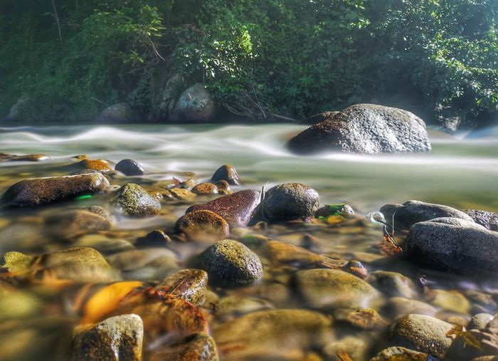 View of rocks and cold water stream.