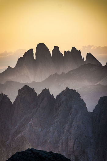 Scenic view of dolomites against sky during sunset