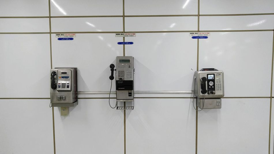 analogue survivors in a digital world White Background Tiles Phone Telephone Public Telephone Pattern Urban Photography City Life Underground Connection Communication Indoors  No People Business Finance And Industry Day Landline Phone Pay Phone Phone Cord