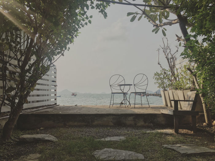 The garden chairs with table set in the backyard with sea view Chairs Table Settlement Garden Sea Couple Sweet Food Romantic