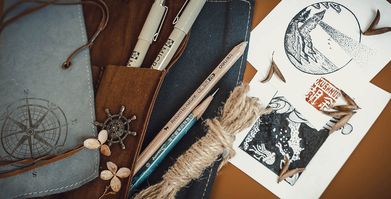 indoors, creativity, high angle view, art and craft, table, still life, no people, craft, representation, variation, publication, choice, book, paper, human representation, large group of objects, directly above, work tool, close-up