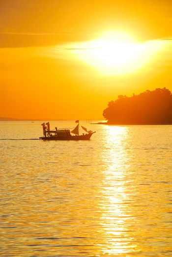 Sunset Orange Color Silhouette Sunlight Sea Beauty In Nature Scenics Ship History Travel Destinations Vacations EyeEm Selects EyeEm Best Edits Sailing Boats⛵️ Sailing Boat PenyengatIsland EyeEmNewHere Stockphoto Decorative Ship Eyeem Select Penyengat Island Landscape Travel Sea Life