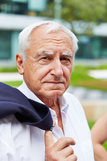 Portrait Of Senior Businessman Outdoors