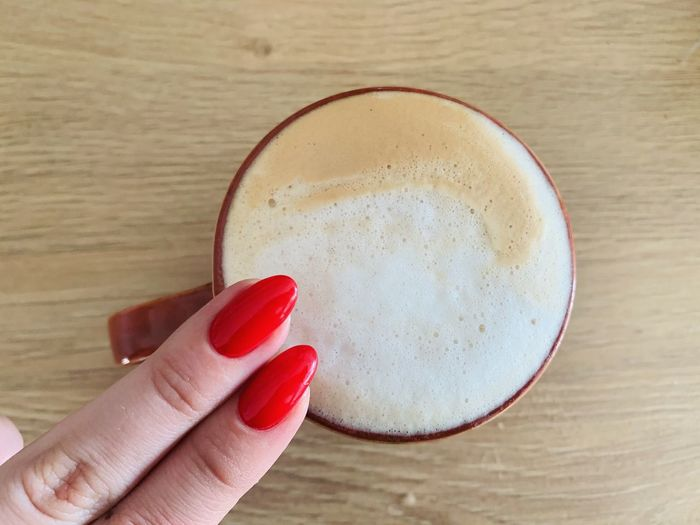 Close-up of hand holding red drink