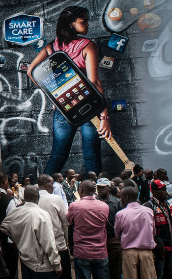 Advertisement Africa Day To Day Leisure Activity Connection Crowd Activity Mobile Phone Lifestyles Smart Phone Communication Photographing Wireless Technology Photography Themes Technology The Week on EyeEm