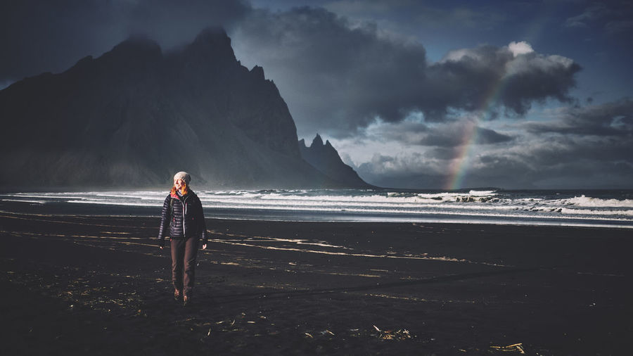 Stormy afternoon, East of Iceland Iceland Stokksnes Woman Beach Beauty In Nature Cloud - Sky Full Length Horizon Over Water Idyllic Land Leisure Activity Lifestyles Nature One Person Outdoors Rainbow Real People Scenics - Nature Sea Sky Standing Tranquility Vacations Vestrahorn Water