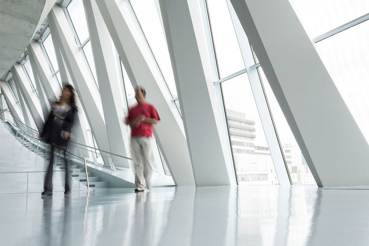 People Rushing through Corridor, Motion Blur Adult Adults Only Blurred Blurred Motion Business Businesspeople Casual Concept Corporate Day Indoors  Men Motion Motion Blur Office Building People Person Stairs Togetherness Two People Unrecognizable Unrecognizable People Unrecognizable Person Walking Women