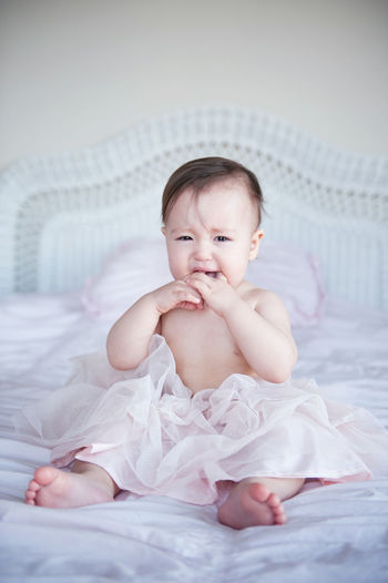 Asian Baby  Childhood Crying Cute Cute Asian Baby Front View Indoors  Innocence Real People Sitting Sitting Teething Tutu