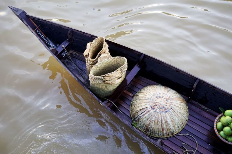 High angle view of baskets on rowboat in lake