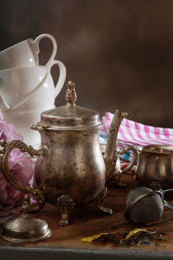 Close-up of tea kettle on table
