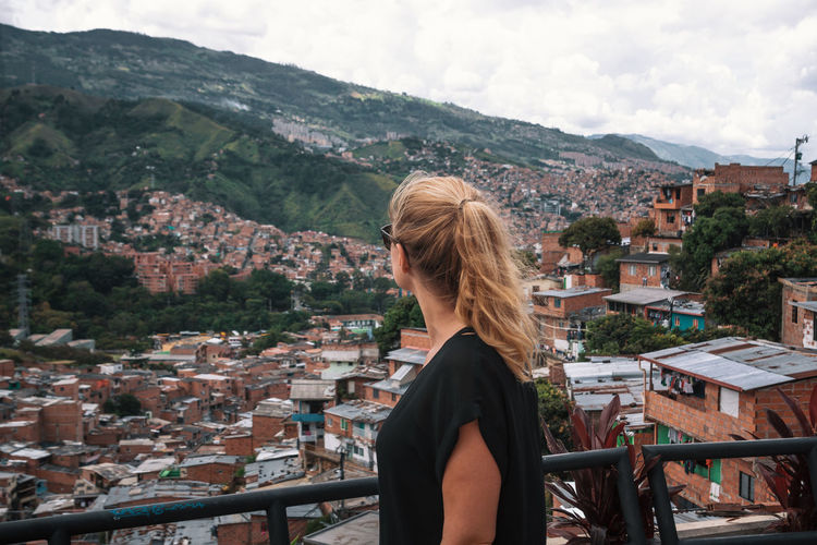 Exploring the city of Medellín. Architecture Building Exterior Built Structure City Nature Outdoors Travel Destinations South America Latin America Explore Urban Mountain One Person Real People Hair Leisure Activity Lifestyles Building Blond Hair Day Adult Rear View Women Town Sky Looking At View Hairstyle Cityscape TOWNSCAPE