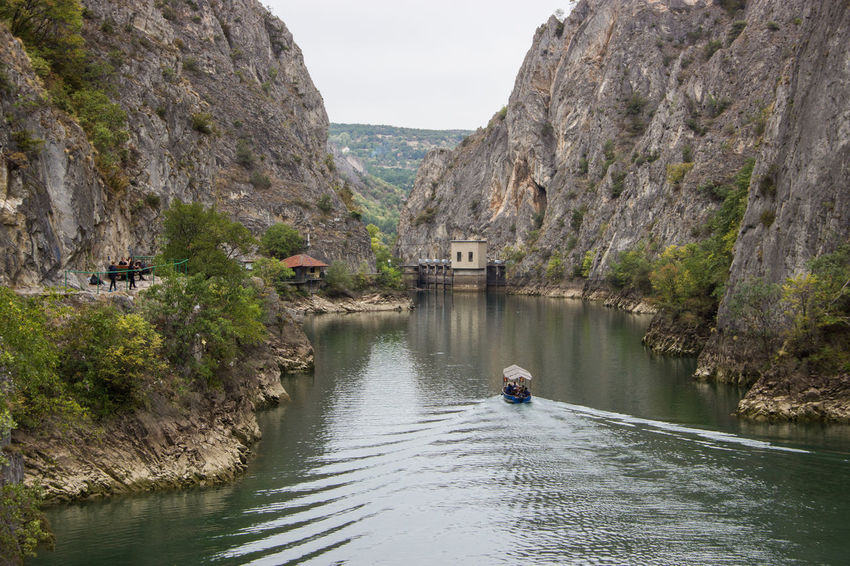 Matka lake near Skopje, Macedonia Rock Starting A Trip Travel Adventure Architecture Beauty In Nature Bridge - Man Made Structure Cliff Day Lake Lake View Mountain Nature One Person Outdoor Outdoors People Real People River Rock - Object Rock Formation Sky Travel Destinations Tree Water
