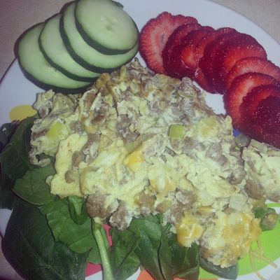 Breakfast- 1 egg 2 whites, turkey sausage crumbles, spinach, cucumber and 3 strawberries. LoL presentation makes a difference IMO. Lowcarb Lowfat EatHealthy Onamission