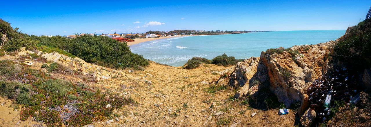 Heaven And Hell Idiots Dropped Empty Beer Bottles Behind A Paradise Beach Punta Braccetto Ragusa Sicily Italy Travel Photography Travel Voyage Traveling Mobile Photography Fine Art Panoramic Views Nature Shorelines Sand Beaches Sea Waves Trash Litter Mobile Editing