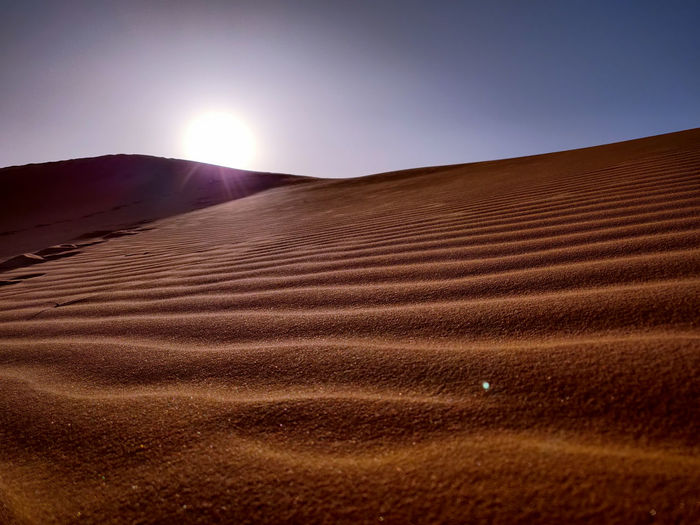 Scenic view of desert against clear sky