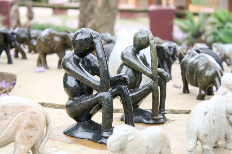 Miniature stone made statues of thinking humans (African Art) AFRICAN CULTURE African African Art Statue Thinking Africa Art Craft Humans Stone Stone Material