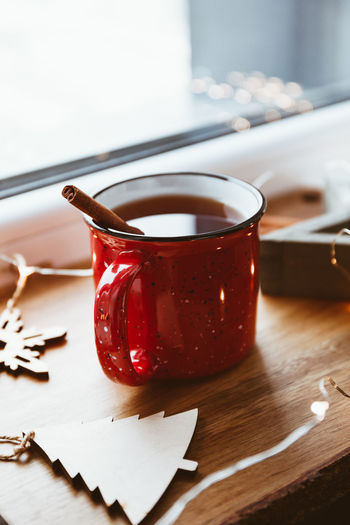Close-up of christmas decorations and tea cup on table