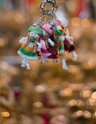 Close-up of key ring with human representation hanging for sale at market