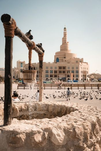 Fanar Mosque Corniche Culture Cultures Middle East Mosque Souq Gold Doha Qatar Fanar Architecture Built Structure Building Exterior Sky Beach Nature Building Religion Belief Day Clear Sky Land Travel Destinations Spirituality Incidental People Place Of Worship Outdoors Water Sand City Capture Tomorrow