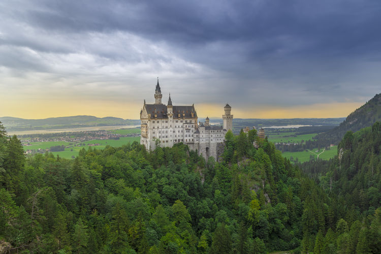 Cloudy sunset during the summer at the neuschwanstein castle, south germany