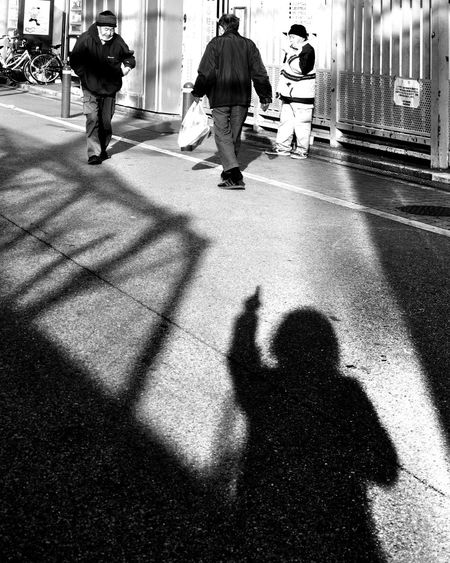 I've seen all good people turn their heads each day Black & White Adult City City Life Day Finger Pointing Focus On Shadow Group Of People IPhone Photography IPhoneography Lifestyles Men Mobile Photography Mobileography Monochrome Outdoors People Real People Road Shadow Street Street Photography Sunlight