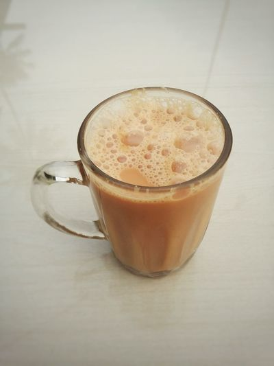 """""""Teh tarik"""" Drink Refreshment Drinking Glass Frothy Drink Indoors  Healthy Eating Close-up Latte Teh Tarik (Malaysian Pull Tea) Popular Drink In Malaysia Mamakrestaurant Malaysian Culture Malaysian Food And Drink Mamak Style Malaysia Truly Asia"""