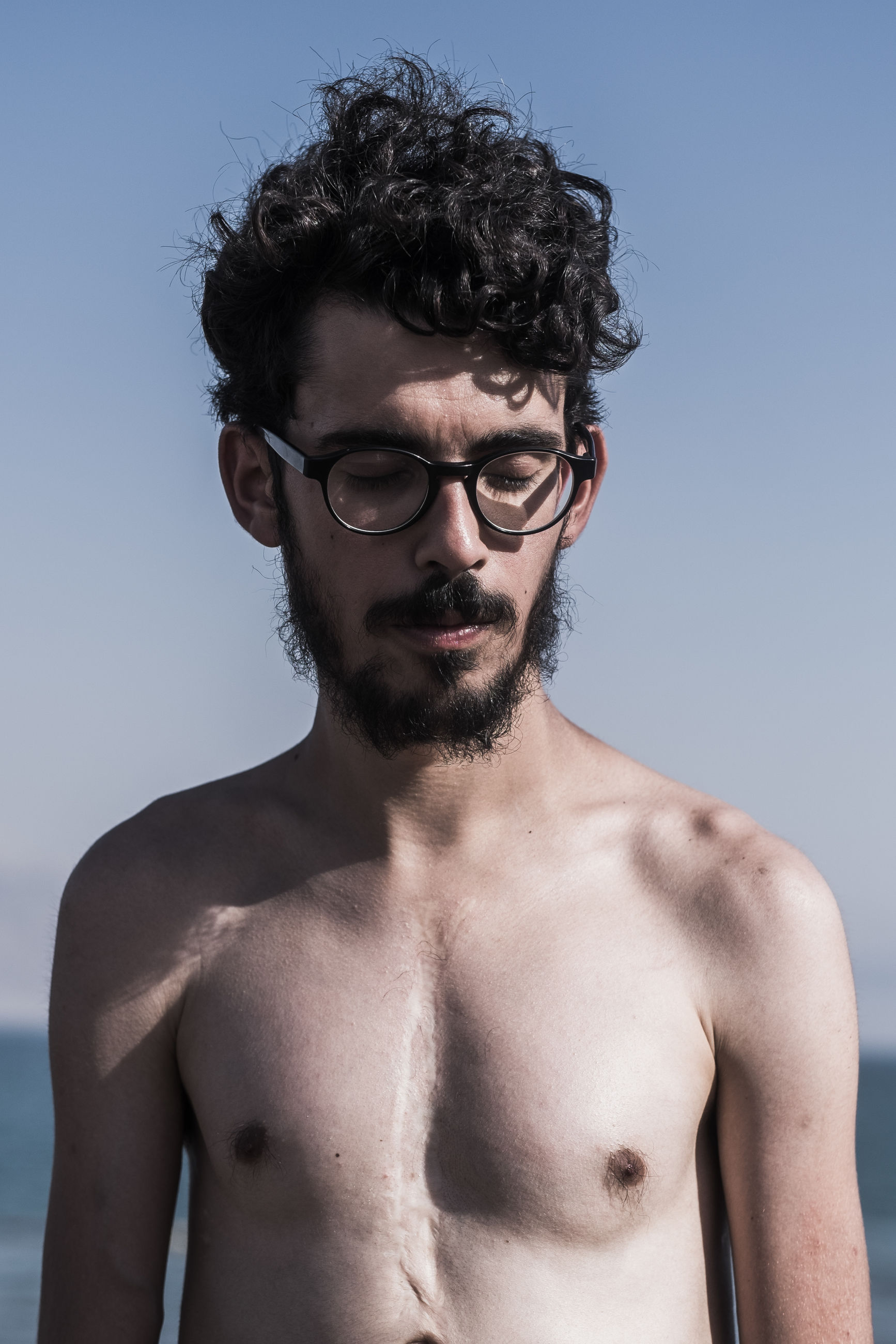 portrait, young adult, looking at camera, person, young men, front view, lifestyles, headshot, leisure activity, smiling, mid adult, beard, sunglasses, shirtless, mid adult men, head and shoulders, confidence