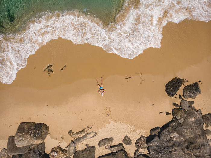 2018 was a lot like drone flying, hiking, beach and sunlight! Aerial drone shot of myself on an Australian beach with rocky backdrop. 2018 In One Photograph Water Nature Day Sea High Angle View Beach Outdoors Rock Drone  Drone Photography Dji DJI Mavic Air Happiness Enjoying Life Enjoying The Sun Hiking Adventures Ocean Surf Sandy Beach Wave Australia Birds Eye View One Person Dreaming