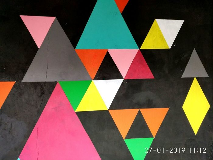 abstract triangle on the wall Abstract Backgrounds Background Triangle Shape Abstractart Abstract Art Abstract Backgrounds Abstract Photography Multi Colored Neon Triangle Shape Road Sign Direction Geometric Shape Close-up