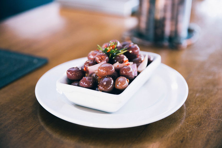Olive Berry Fruit Close-up Dessert Focus On Foreground Food Food And Drink Freshness Fruit Healthy Eating Indoors  No People Olives Plate Ready-to-eat Selective Focus Snack Still Life Sweet Sweet Food Table Temptation Wellbeing Wood - Material