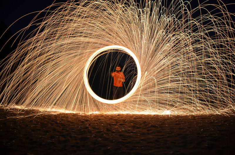 Circle Long Exposure Illuminated Motion Wire Wool Burning No People Tunnel Light Effect Night Close-up Outdoors Sky